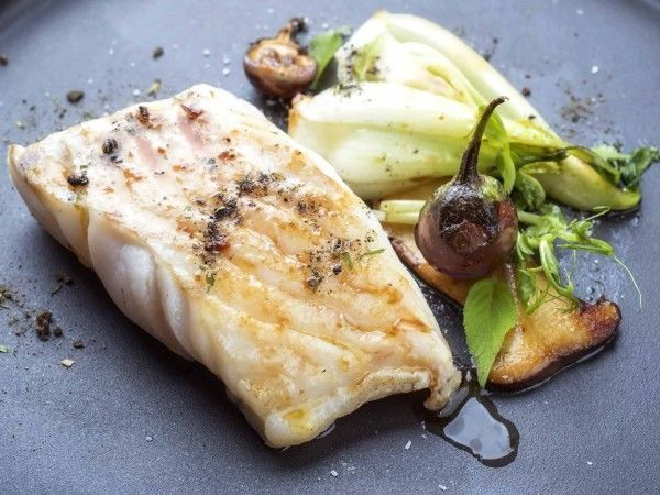 A cooked skinless hake fillet steak