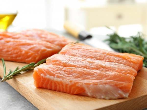 Two raw salmon fillet portions