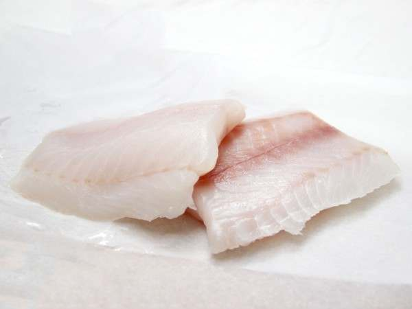 Two raw fresh pollack fillet portions