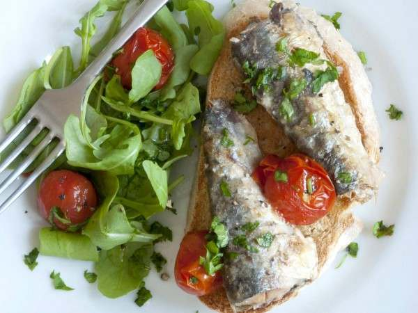 Sardinillas on toast with salad