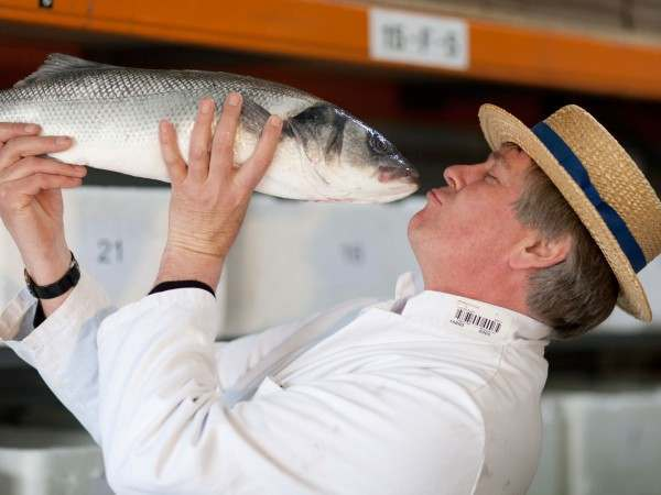 Alistair pretending to kiss a fine sea bass