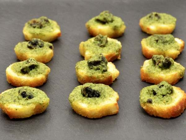 Cooked escargot canapes