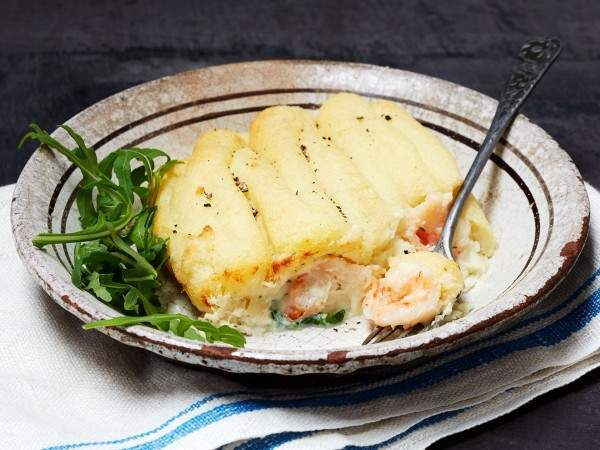 Cooked handmade fish pie on a rustic plate