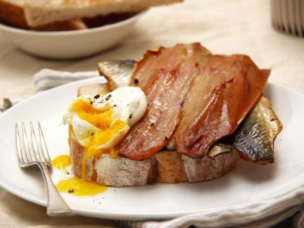 Boned kipper fillets on toast with a poached egg