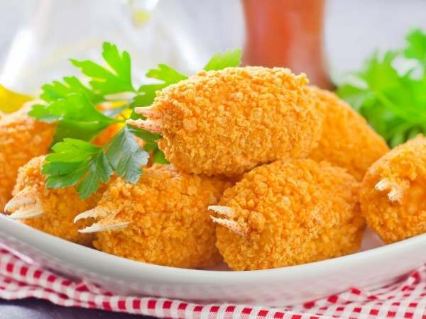Cooked breaded crab claws with dipping sauce