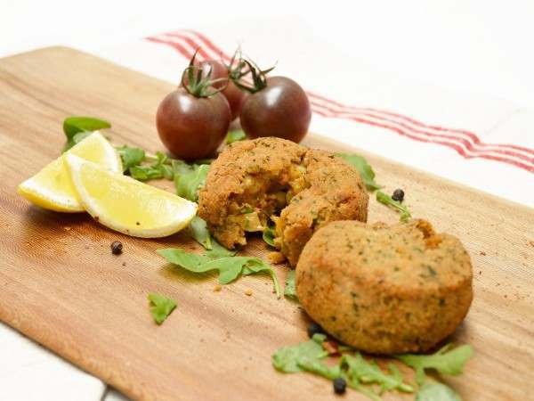 Two cooked handmade crab cakes