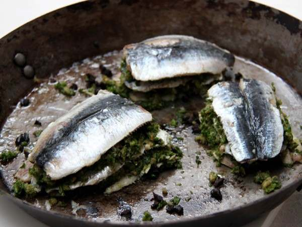 Butterflied sardine fillet stacks in a pan