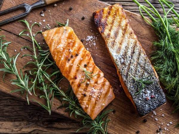 Two cooked king salmon fillet steaks