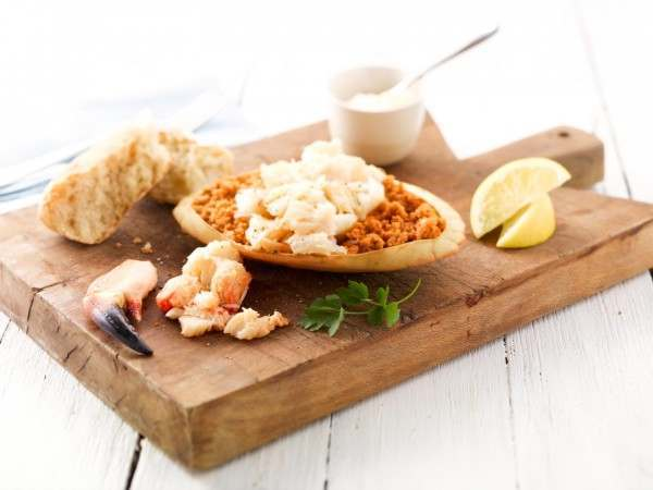 A dressed crab on a wooden chopping board