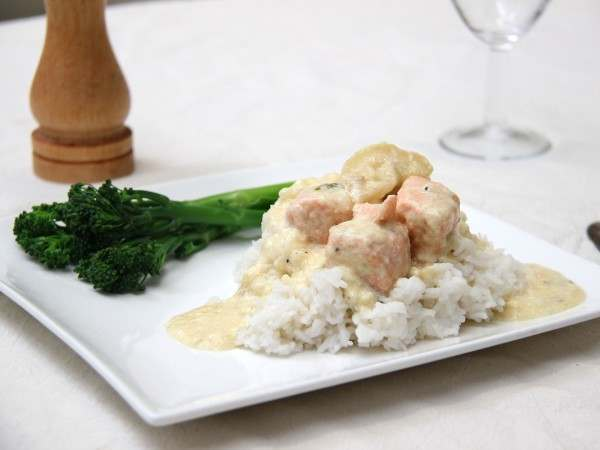 Salmon and whiskey cream sauce on rice