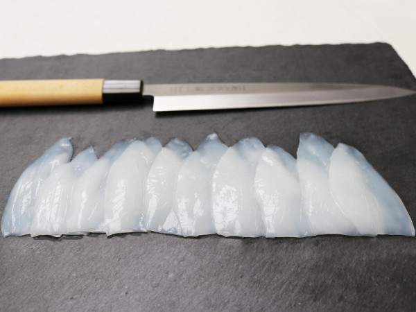 slices of squid on a slate board