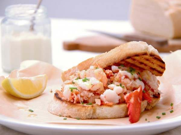 Cooked lobster meat on toast