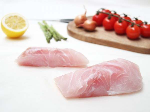 Two portions of skinless nile perch fillet steaks