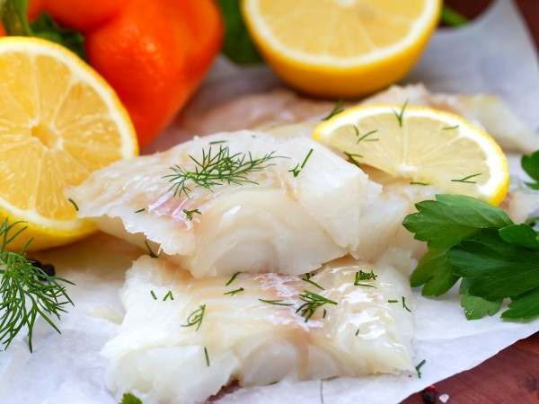 Wolf fish misshapes with dill and lemon