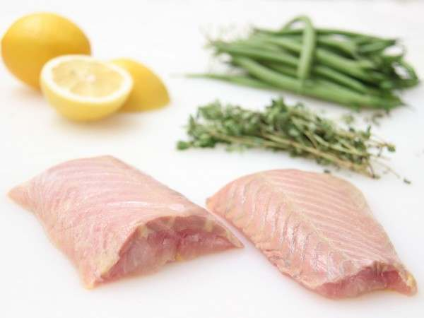 Two skinless sturgeon fillet steaks