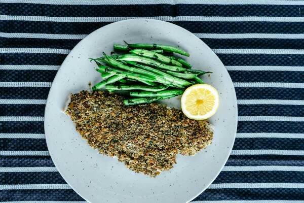 Crunchy crumbed plaice fillet with buttered green beans