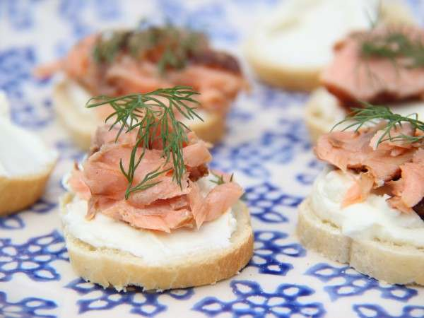 Hot smoked salmon with cream cheese and dill on baguette