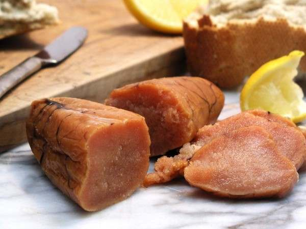 A smoked cod roe sliced in half and in thin slices