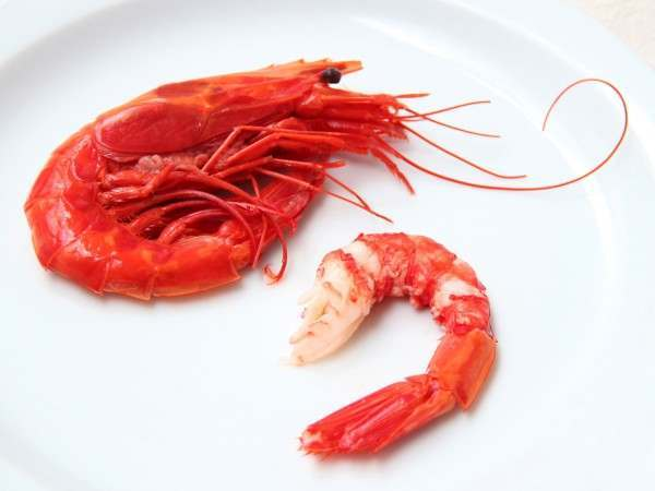 A whole carabineros and a peeled carabineros tail