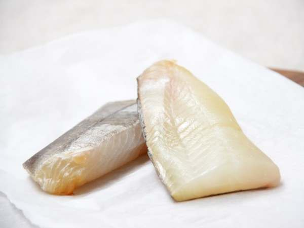 Two whole golden bullets of smoked haddock on white paper